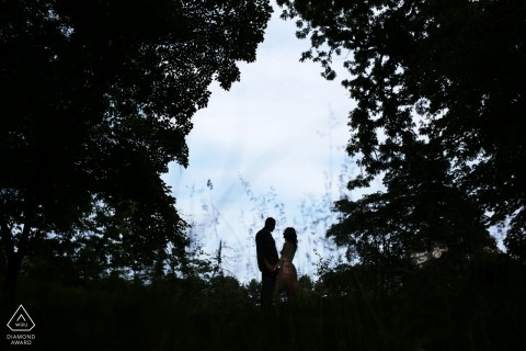 Arnold Arboretum Boston engagement photograph of couple shot through the grass