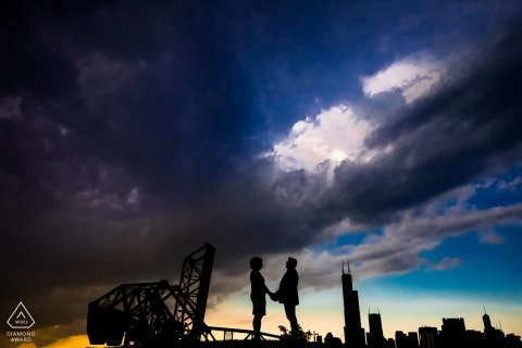 Chicago couple session with city skyline behind them at sunset