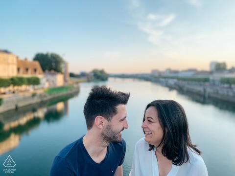 Chalon-sur-Saône, France Engagement Session - A sweet exchange by the bridge over the Saône.