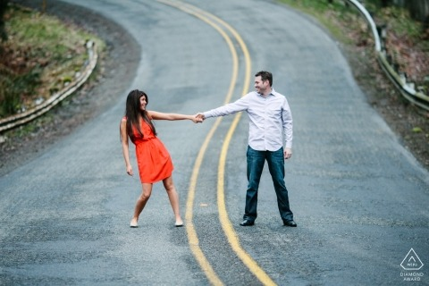 Bonney Lake, WA | Engaged couple holding hands in middle of the curving street