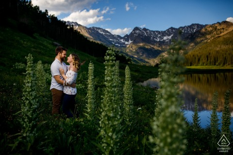 The couple embraces during their engagement photography session at Piney Lake near Vail, Colorado