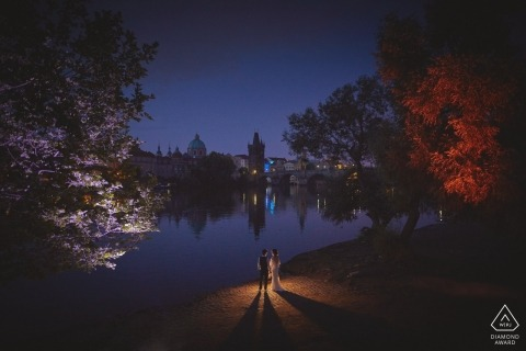 Riverside looking towards the Charles Bridge, Prague, Czech Republic Engagement Portraits - Happy couple during their pre sunrise portrait session