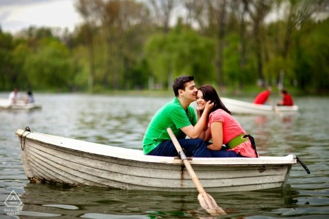 Tineretului park engagement portrait session with a couple posing in a boat on tineretului park