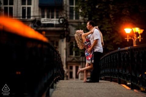 Bucharest Dambovita River Engagement Shoot with a couple posing on a bridge
