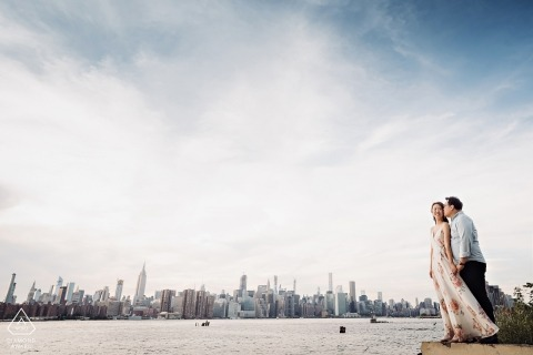 East River State Park - portrait of engaged couple at the water with city skyline