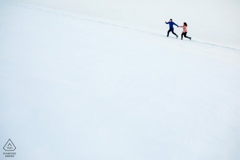 Dillon, CO engagement session with couple running in the white snow