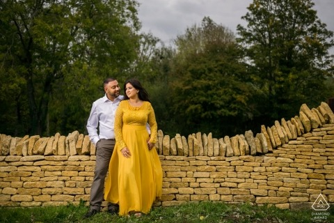 Cotswald Airport, UK Couple Portrait by Stone Wall