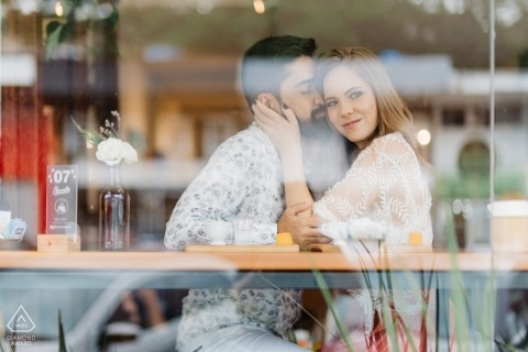 Ernesto Café - Brasilia - Brazil Engagement Shoot - Couple having a good time at cafe with window reflection.