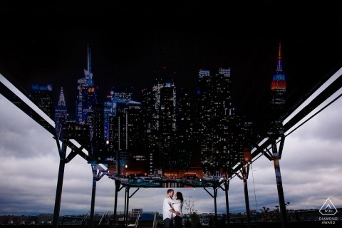 The Highline New York Engagement Photographer: It was raining and we couldnt do much at dumbo so we went tot he highline and I later double exposed NYC skyline for them since we never got it because of the rain.