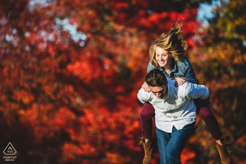 Stroud Preserve, West Chester PA Engagement Photos during fall | Taking a ride on the grooms back. Fun + color + moment/light