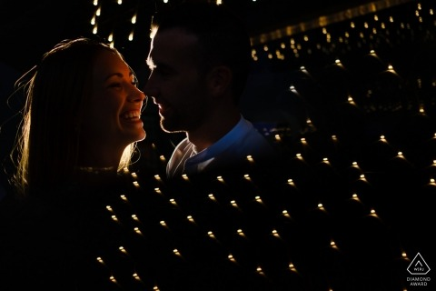 Alicante prewedding photo session under the lights at night.