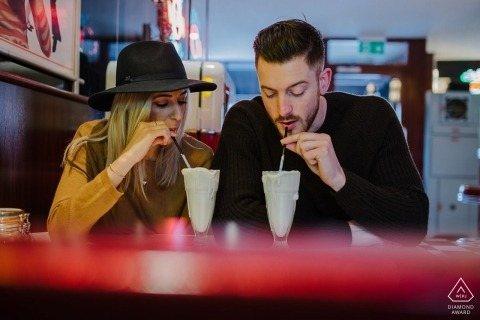 Cheltenham pre-wedding shoot with a couple sipping shakes through straws.