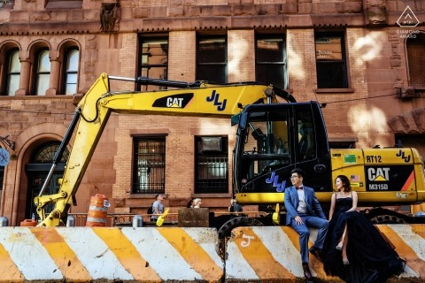 soho couple sitting on in front of a construction equipment during prewedding session