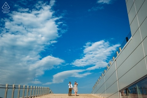 """""""This engagement photo was taken at the top of the stairs of the Grand Quai in Old Montreal. There's a nice view from up there, but it was a very hot day and the sun was intense."""""""