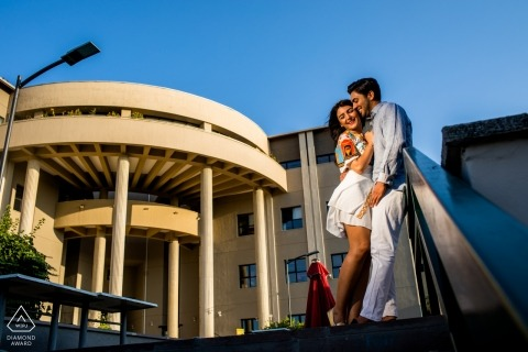 Couple is standing on the stairway during prewedding photoshoot at Bilkent University