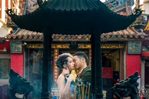 Xiahai Chenghuang Temple Photography - The engaged couple were kissing in front of the incense burner of the temple.