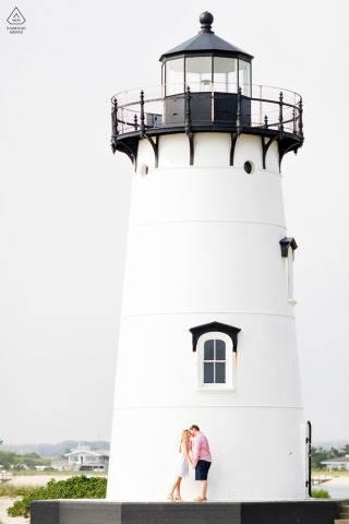 Engagement portrait of a couple at a New England lighthouse in MA