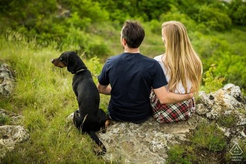 Stránská Skála couple enjoying the view with their dog during portrait shoot