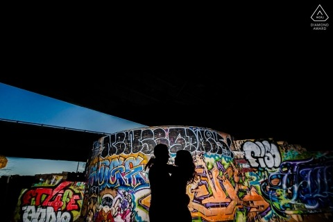 FDR skate park photo session | Using the graffiti to silhouette the couple with flash.