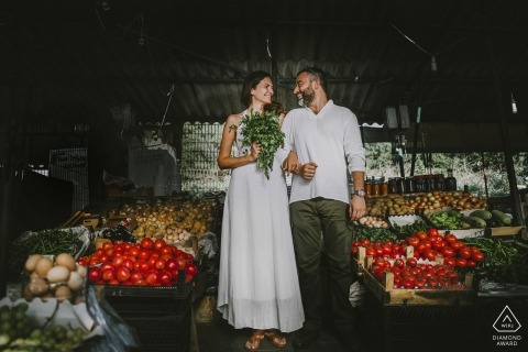 İstanbul couple shopping in a traditional bazaar during pre-wedding portrait shoot