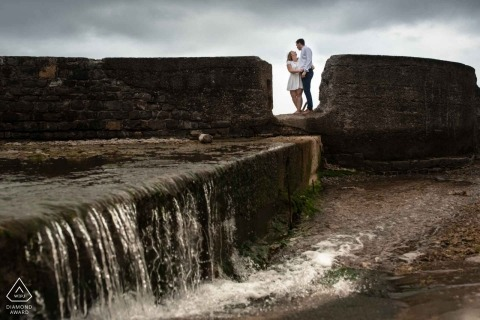 Engagement Photos from Hendaye France - Portrait contains: couple, rocks, waterfall, shore