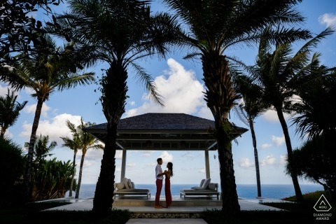 Engagement Photos from Bali, Indonesia | Blue sky and white clouds, coconut leaves leave everything beautiful