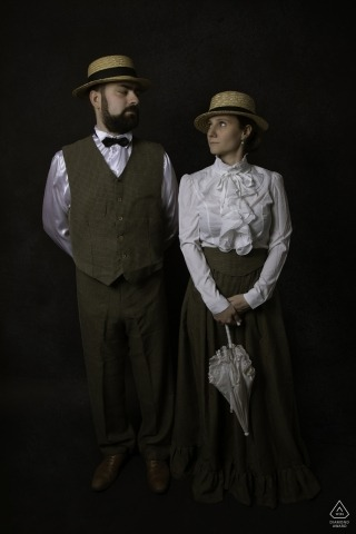 Engagement Photographer for Nancy (France) - Image contains: couple, portrait, parasol, 1800's apparel, studio