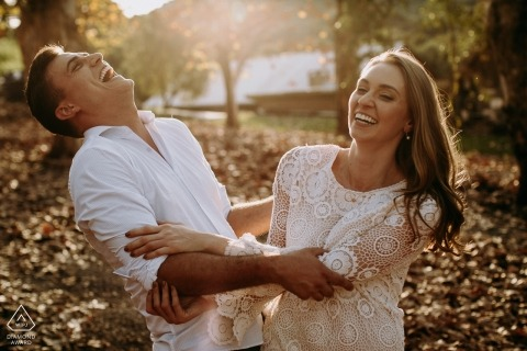 Engagement Photographer for Bento Gonçalves - Brasil - Image contains: water, couple, leaves, trees, laughing, fun