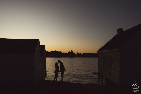 Engagement Photographer for Willard Beach South Portland Maine - Portrait contains: silhouette, couple, buildings, water