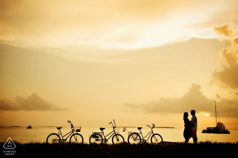 Engagement Portrait from Fort Zach, Key West - Photography contains: silhouette, couple, bicycles, water, clouds