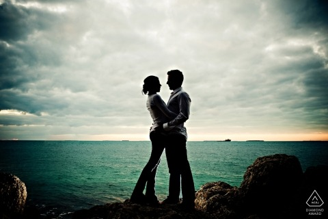 Engagement Photography for Key West - Portrait contains: couple, silhouette, sky, water, rocks