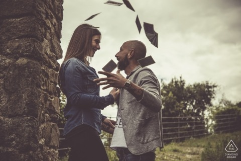 Engagement Photography for Bolano - Image contains: couple, stone, wall, column, gates, fence