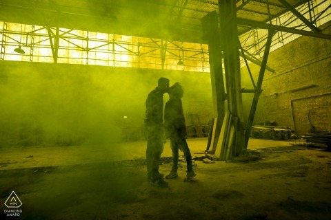 Engagement Photos from Ceparana - Portrait contains: couple, silhouette, warehouse, abandoned, smoke, kiss, industrial