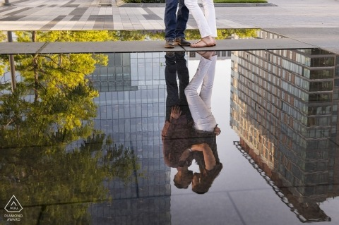 Engagement Photographer for Seaport, Boston, Massachusetts - Reflection of couple kissing