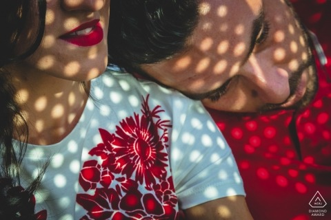 Engagement Photos from Siracusa - Portrait contains: couple, close-up, shadows, dots, red