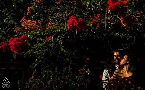 Engagement Portrait from Brazil | Maceió, AL Couple among flowers and under soft light