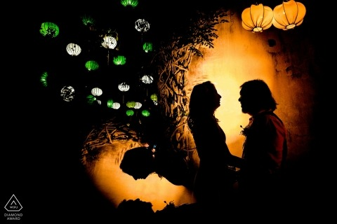 Engagement Portrait from Da Nang  - Image contains: silhouette, couple, lanterns, lights, spotlight