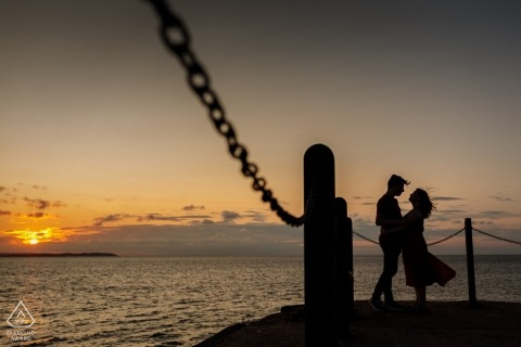 Engagement Portrait from Whitstable Harbour, Kent, UK | The couple embrase at the end of the pier at sunset