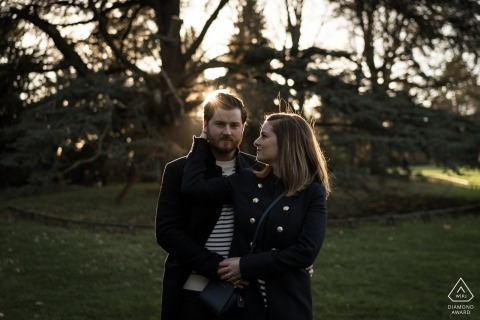 Engagement Photographer for Rennes, France - Pre-wedding Image contains: couple, portrait, trees, grass, park