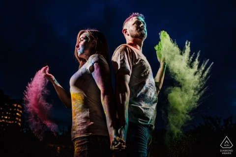 Engagement Photographer for Maryland at Client's Home with holi powder and dramatic lighting