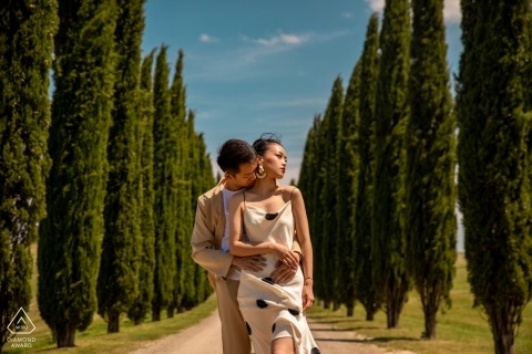 Engagement Portrait from Italia Tuscany - Image contains: couple, hug, lane, cypress, dirt road