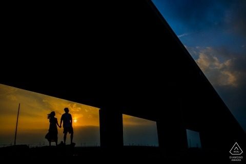 Engagement Photos from Fujian, China - Image contains: pier, beach, sunset, couple, silhouette