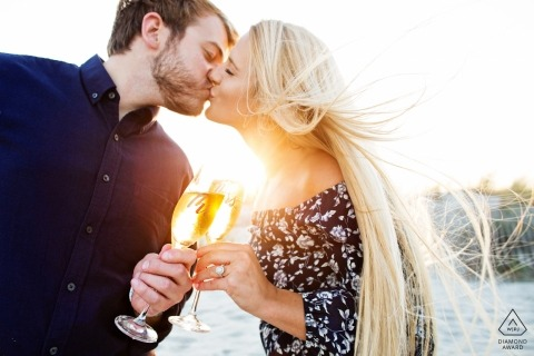 Engagement Photographer for Avalon, New Jersey Beach - Image contains: couple, kiss, beach, wine glasses, toast, engaged