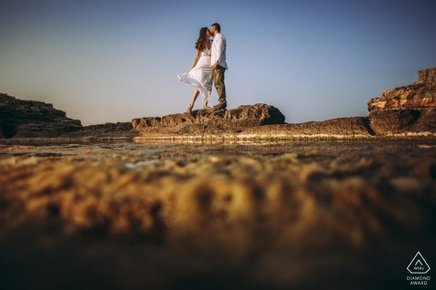 Engagement Photographer for Turkey Istanbul | kissing couple on the rock