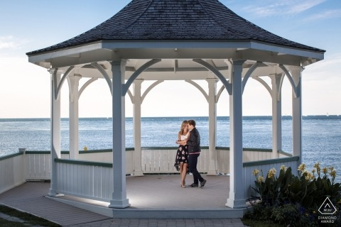 Engagement Photos from Niagara-on-the-Lake, Ontario - Portrait contains: gazebo, beach, water, couple, hug, embrace, ocean