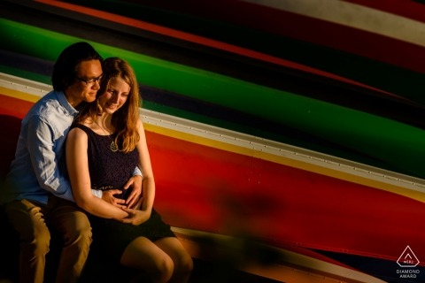 Engagement Portrait from Gantry Plaza State Park | Image contains: Couple portrait with color boats