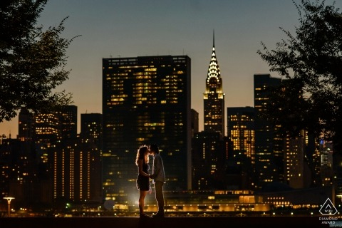 Engagement Photographer for Manhattan, NYC - Gantry Plaza State Park - Couple's portrait with Manhattan night view