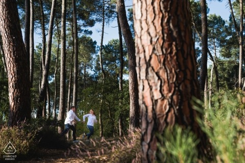 Agen, France engagement picture session in the woods with big trees