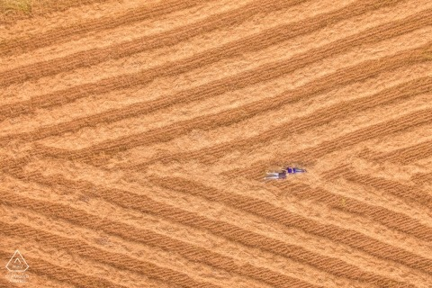 Siracusa engagement shoot - Drone photography of couple lying in field