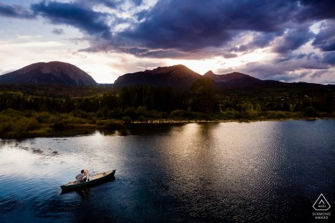 CO Couple canoeing at sunset in front of Buffalo Mountain in Silverthorne.